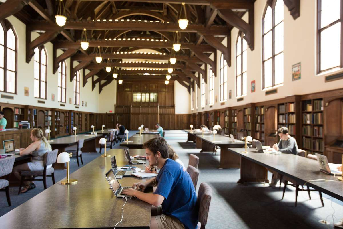 student sitting inside library